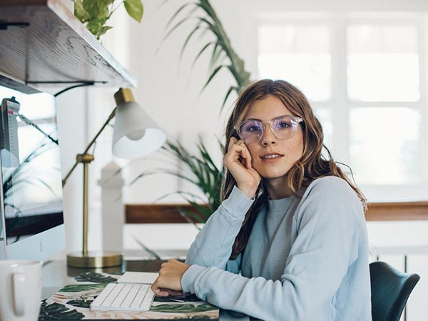 blue light glasses woman wearing clear frames image 1